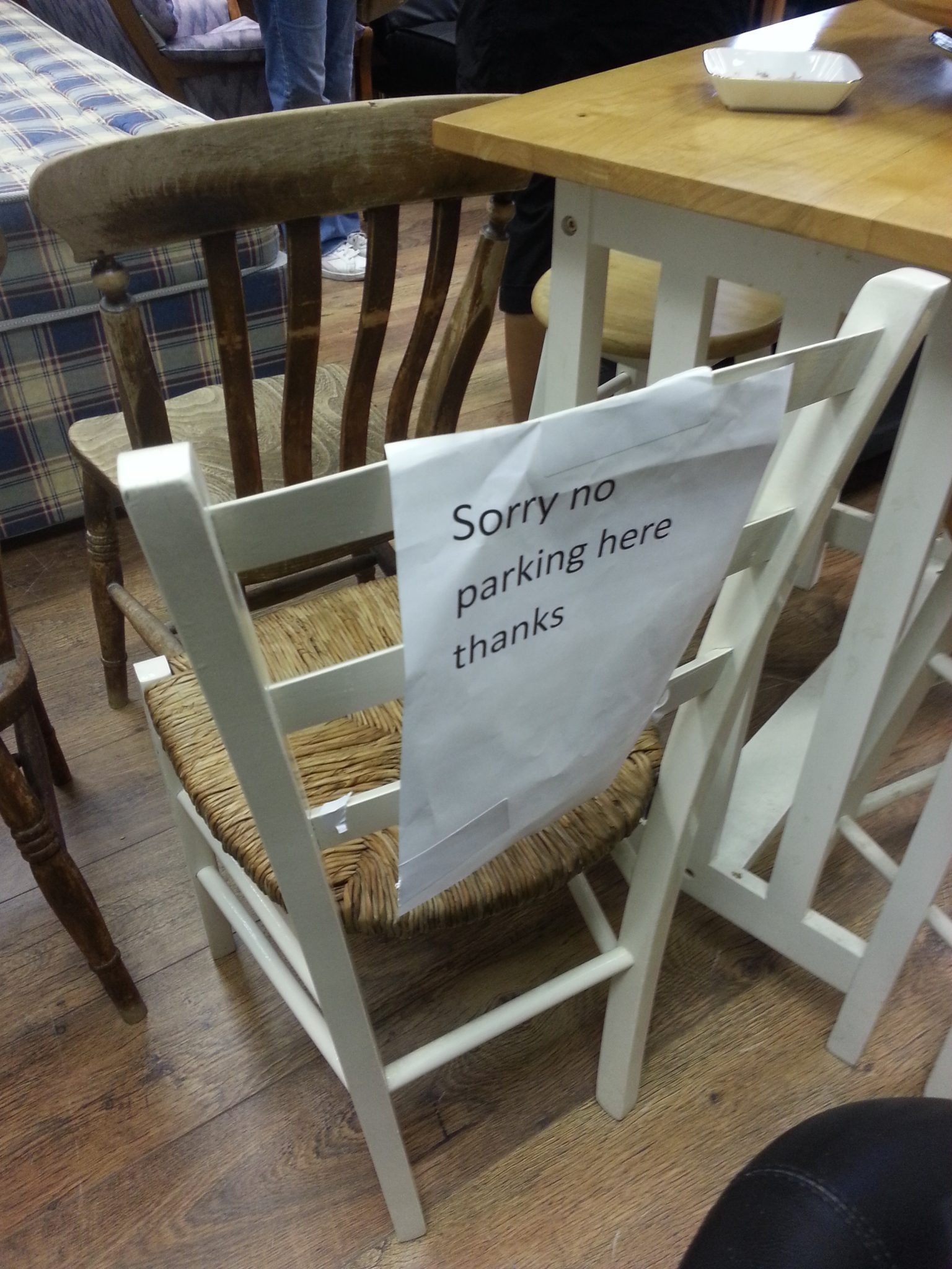 Sign seen on a chair INSIDE a charity shop